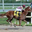 Flora Dora winning the My Dear Girl Stakes (photo from the Courier-Journal)