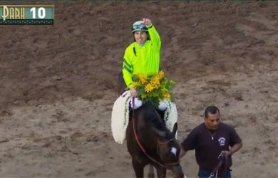 Joe Talamo salutes the crowd after a wire-to-wire score on Melatonin in the Big 'Cap.