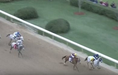 Cupid holds off the furious late charge of Whitmore to capture the Grade II Rebel Stakes at Oaklawn Park on Saturday.