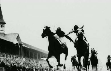 "Jockeys Don Meade (Brokers Tip) and Herb Fisher (Head Play) grabbed and pushed each other down the stretch of the 1933 Kentucky Derby in what was aptly called the ""Fighting Finish."""