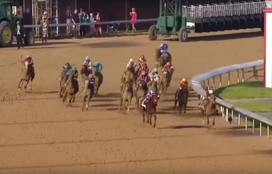 Nyquist (left) takes the lead from Gun Runner (right) as the field turns for home in the 142nd Kentucky Derby.