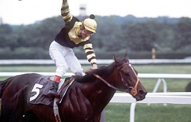 Jean Cruget celebrates after winning the Triple Crown aboard Seattle Slew (photo via CBS News).