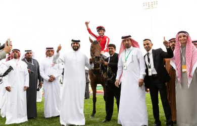 Trainer Fawzi Nass (fourth from right) celebrates Port Lions' win in last year's Neom Turf Cup - Credit: Jockey Club of Saudi Arabia / Neville Hopwood